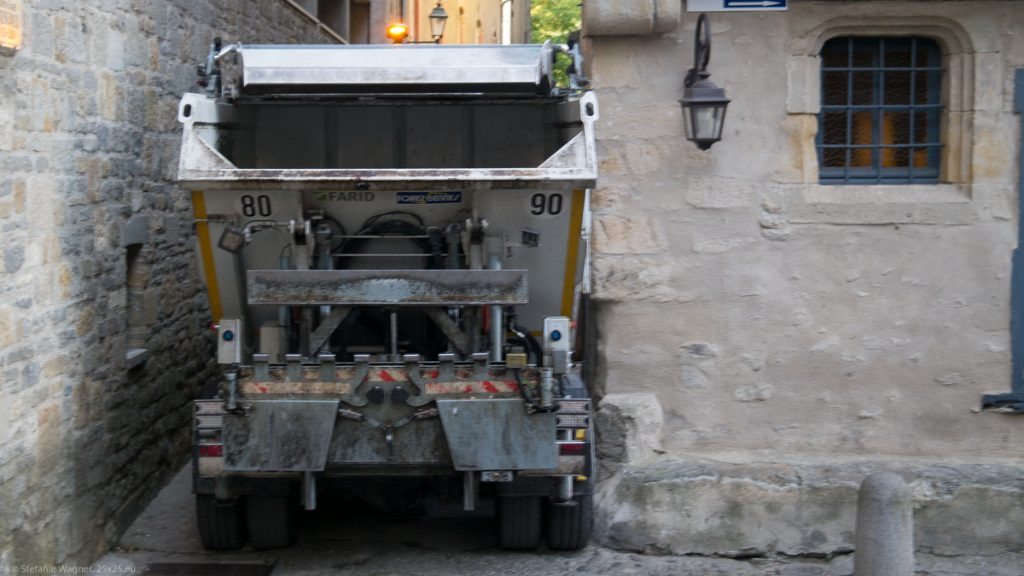 Garbage truck in a very narrow street