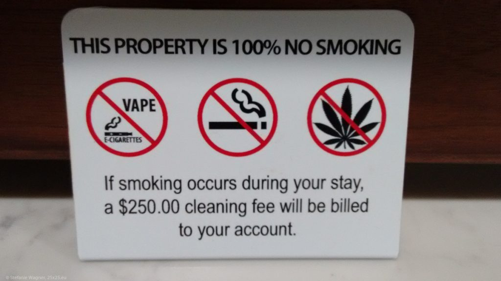 Sign showing multiple prohibitory signs incl. normal cigarettes, e-cigarettes and marihuana