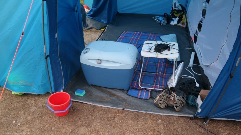 View into a tent with water and dirt