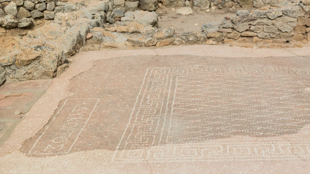 Brownish mosaic with Greek letters on one side