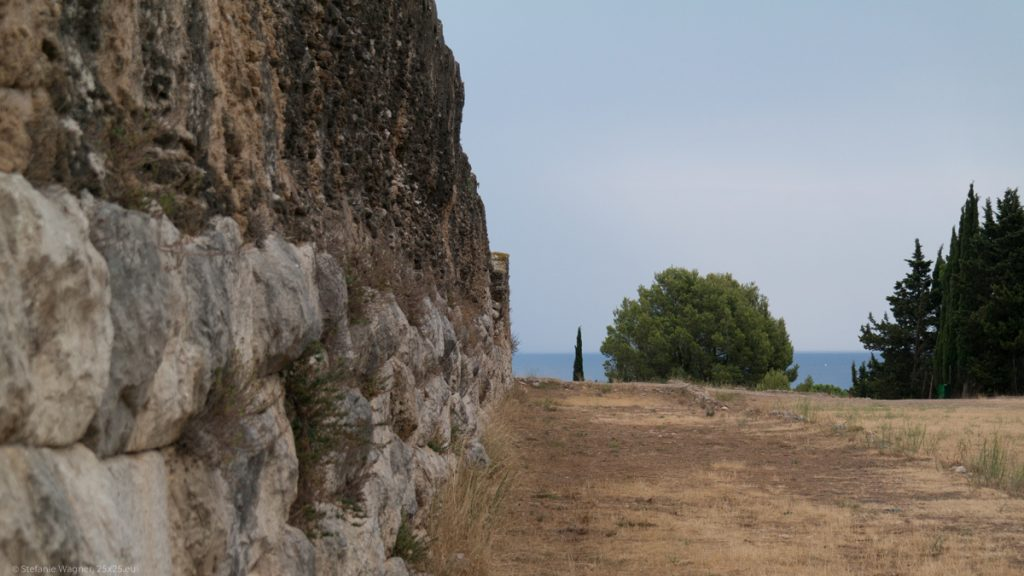 View along an old wall towards the sea