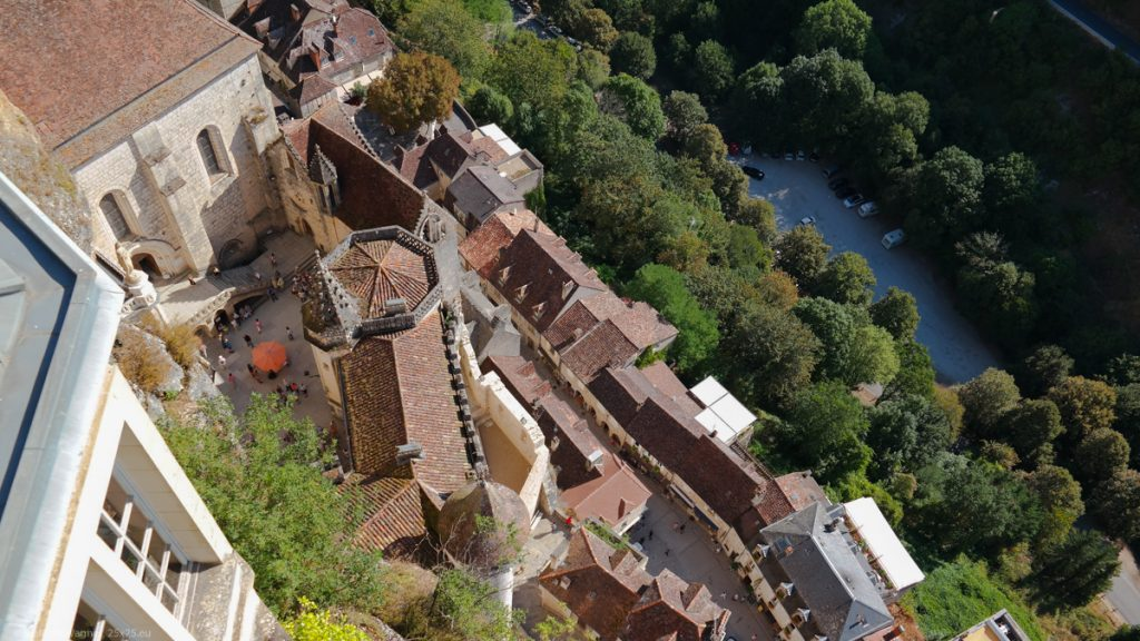View from high above straight down to the churches and the village