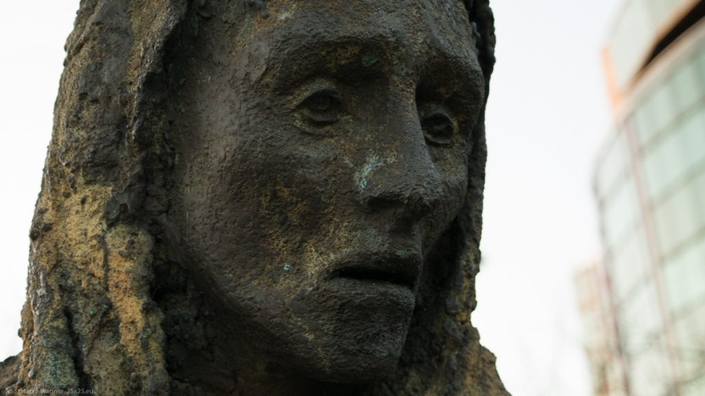 Closeup of one figure of the memorial