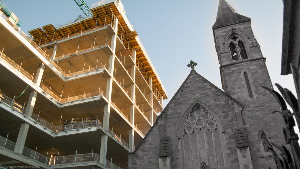 Old stone church to the right, construction site on the left