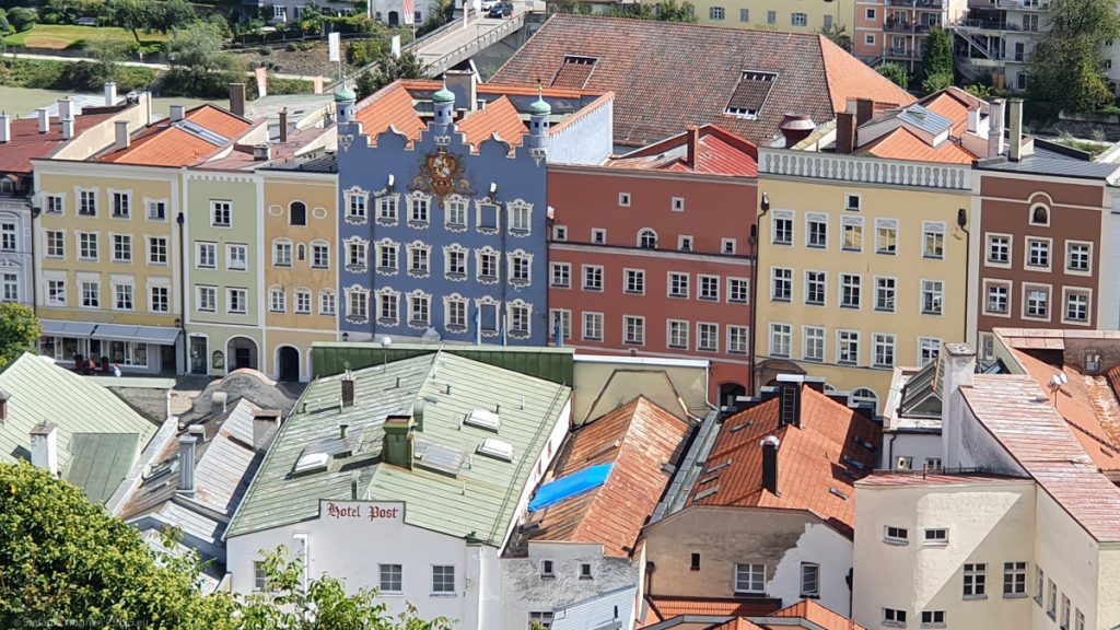 View from the top onto some buildings showing that the front walls are taller than the roofs behind them and that shapes are not symmetrical.