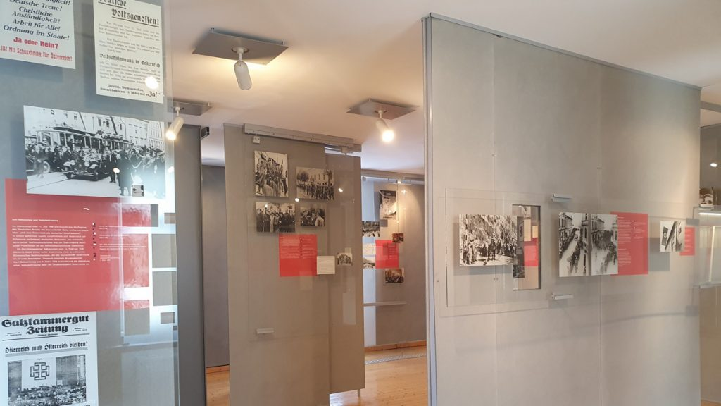 Room in the museum with texts and pictures on display