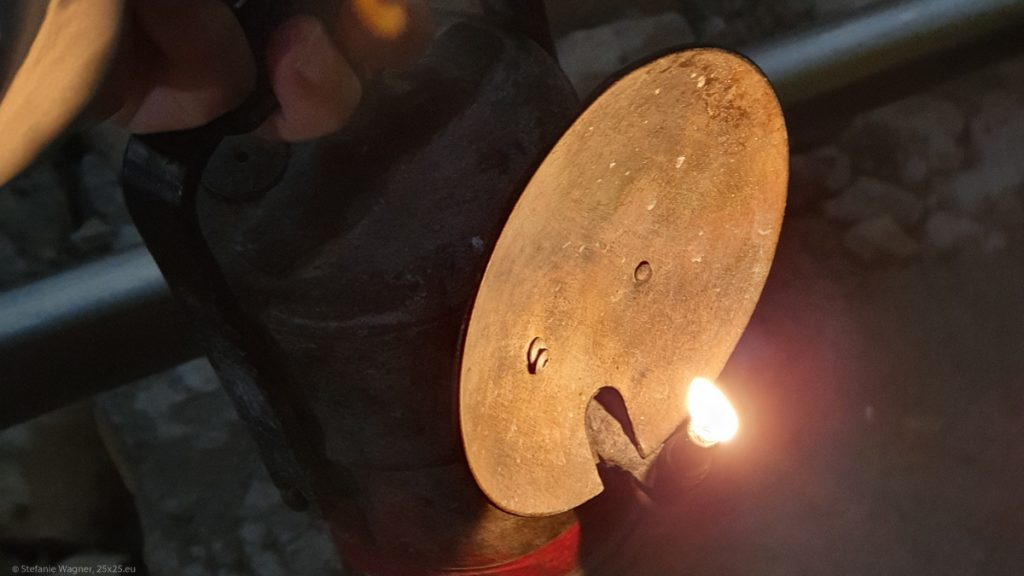 Close view of a lit carbide lamp
