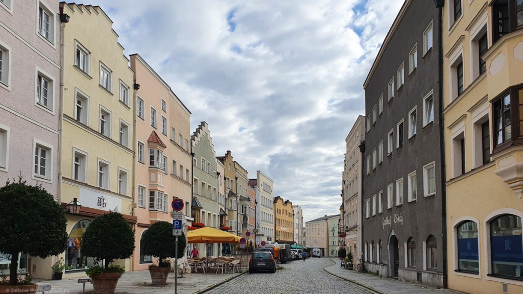 Cobblestone street with old houses on both sides