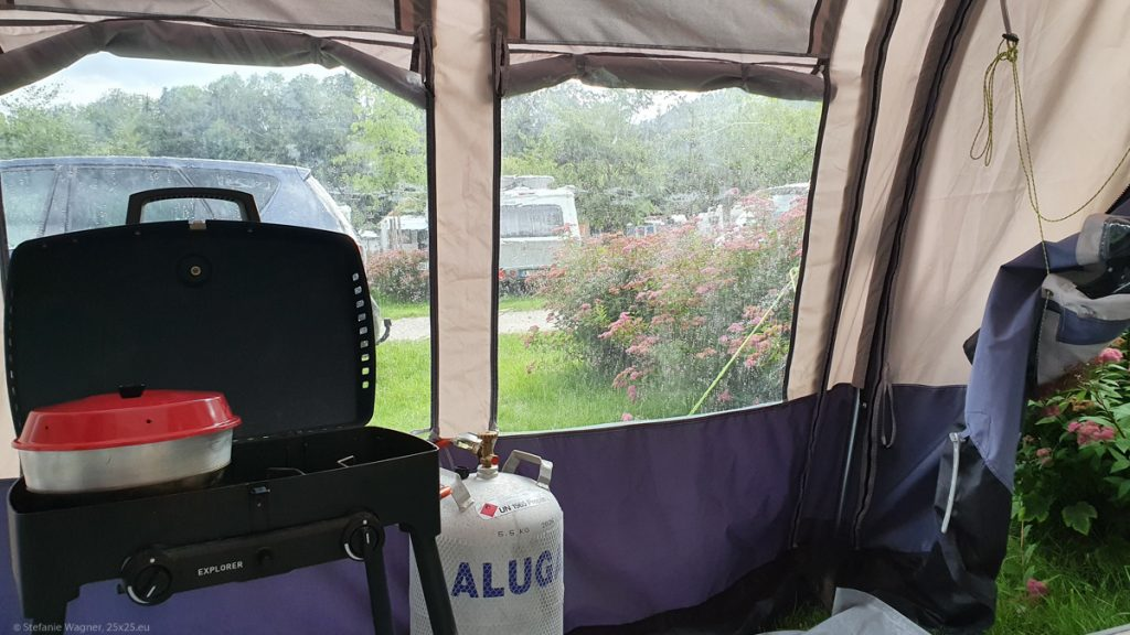 Trailer tent from the inside with rain on the windows
