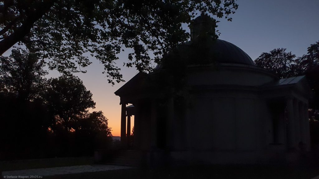 Silhouette of the mausoleum with sunset in the background, round building with a dome