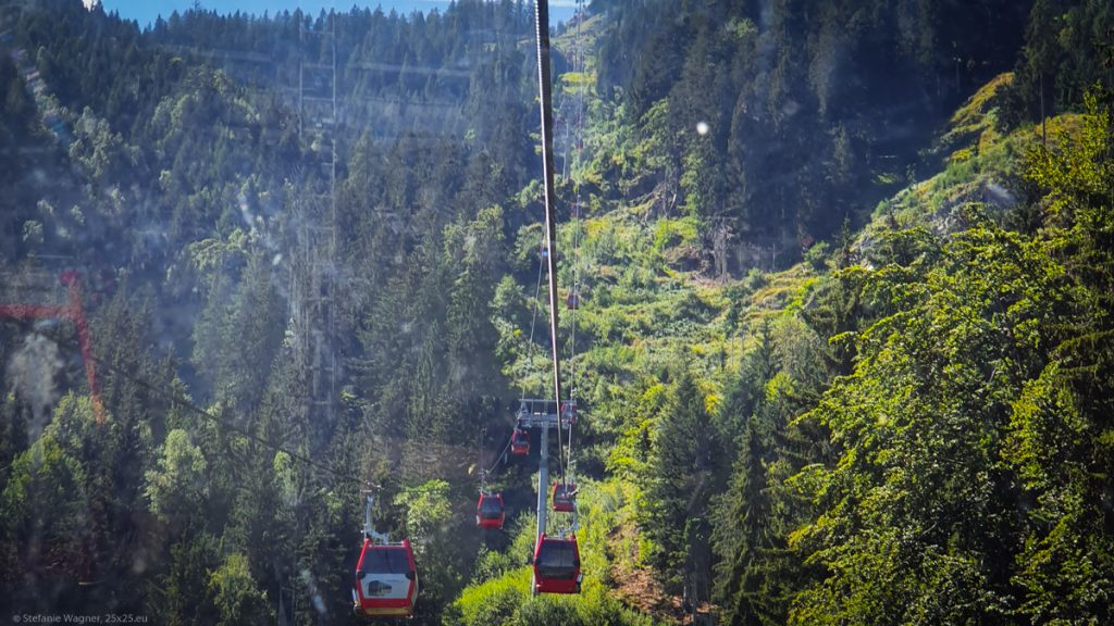 Green hillside with ropeway going up