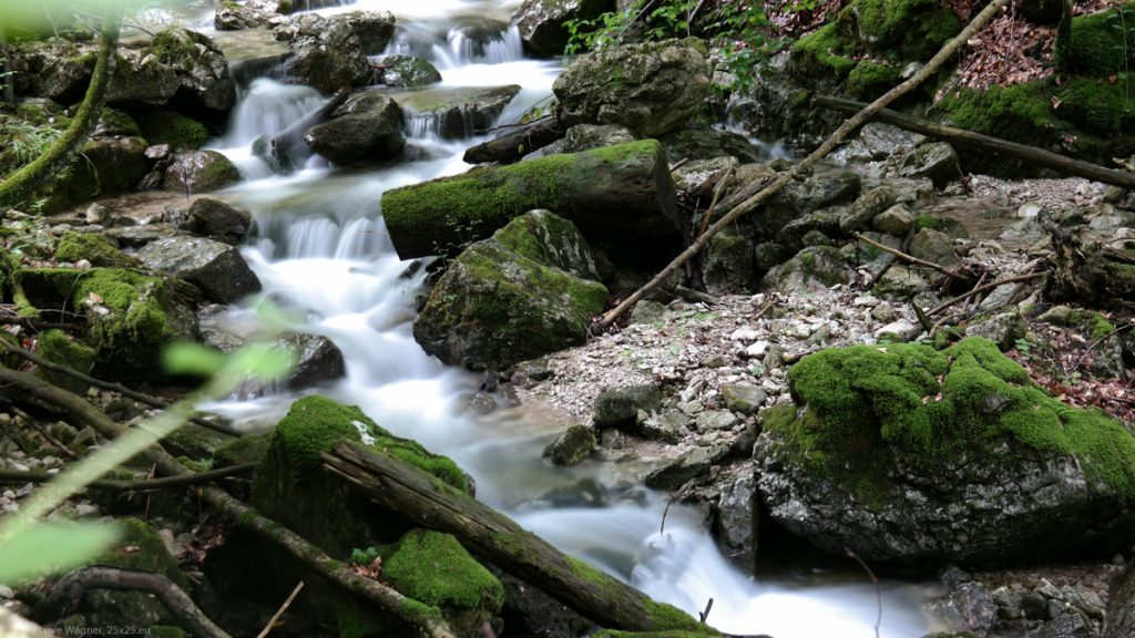 Longterm exposure of a small stream of water between rocks