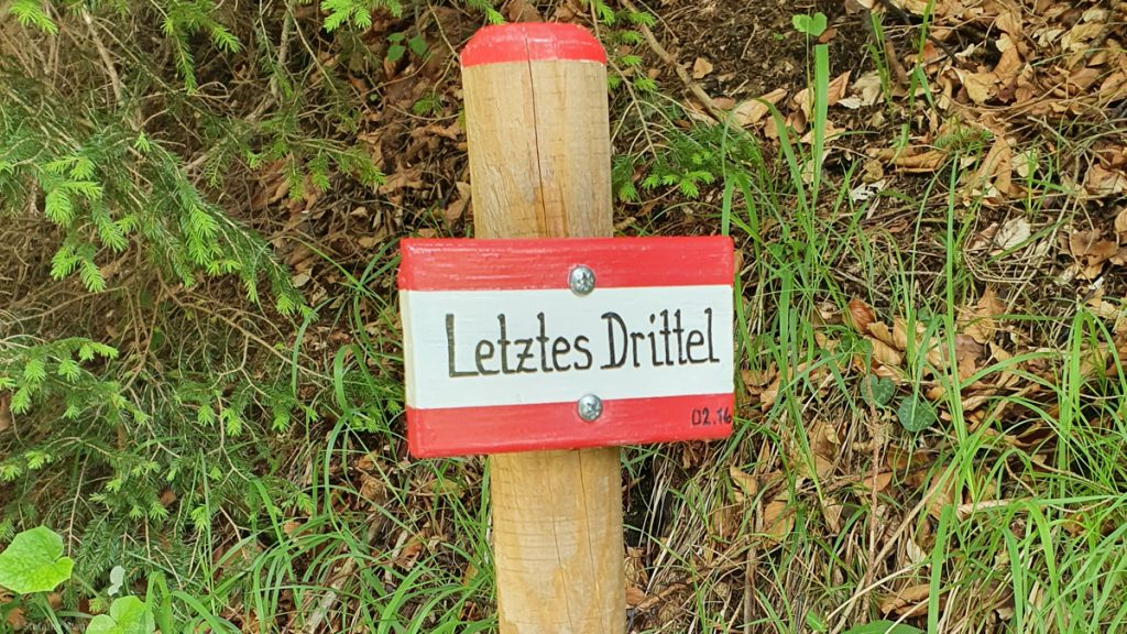 """Sign with text """"Letztes Drittel"""""""