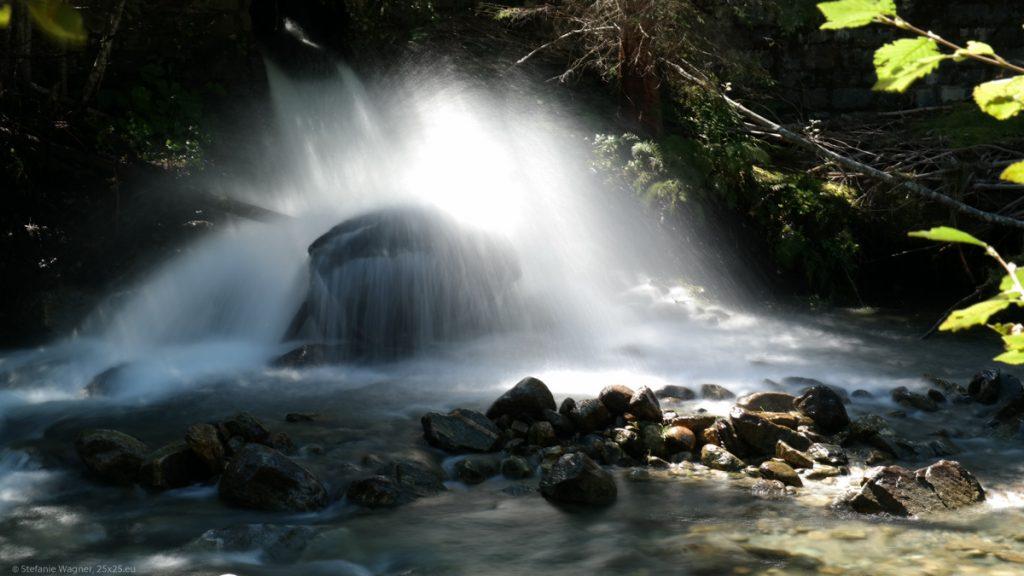 Water splashing on a big rock