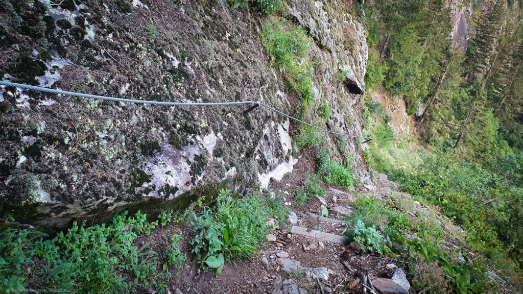Steep path with some small steps and a rope to hold onto