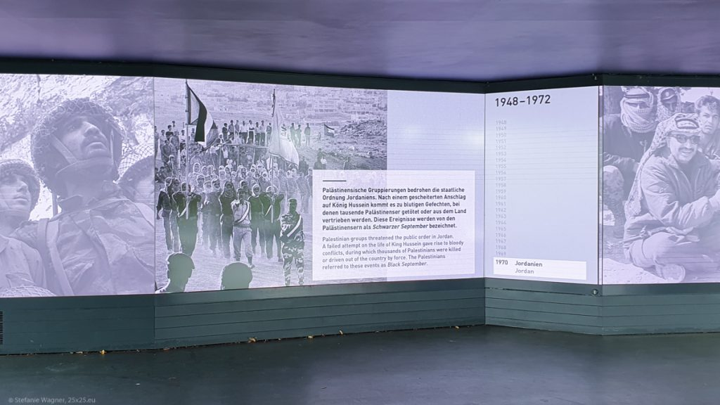 """Videoscreen with pictures and a text explaining about the group """"Black September"""""""