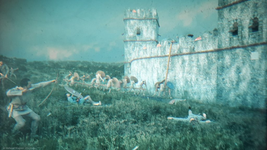 Illustration of the fort with Germans shooting arrows and trying to climb the wall