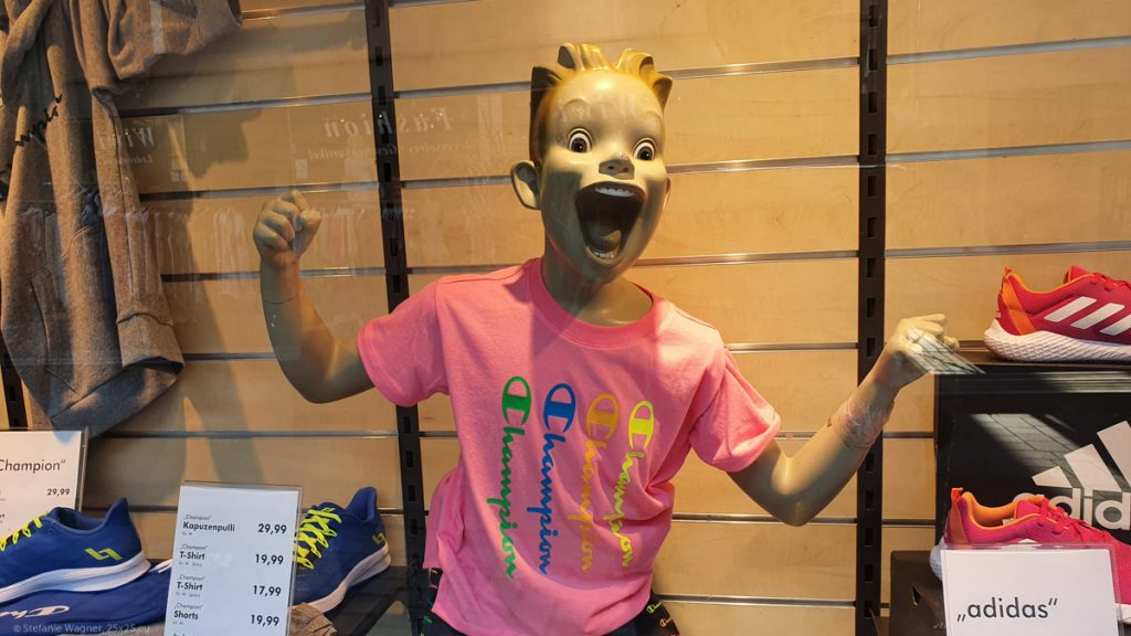 Display dummy representing a child with exaggerated wide eyes and mouth.