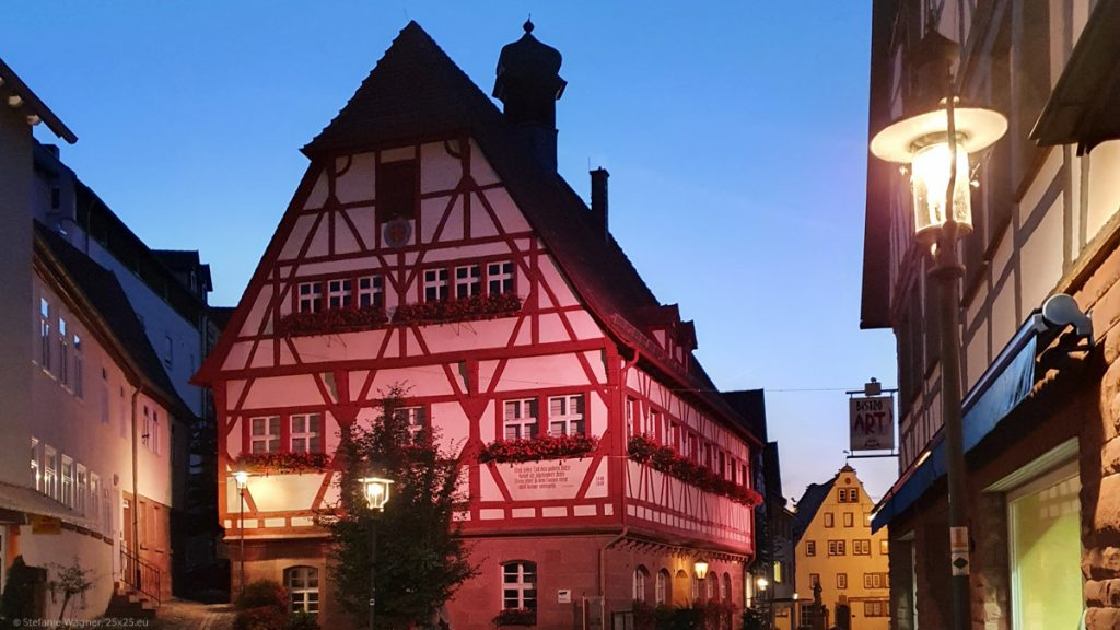 Half-timbered house with red panted wood, after sunset
