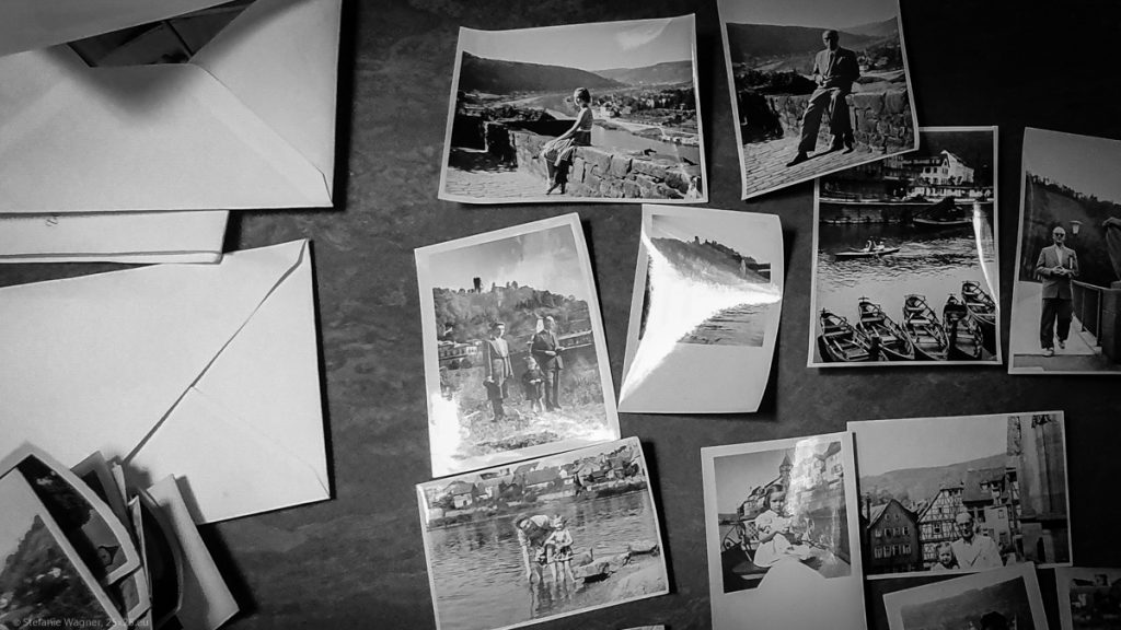 Various black and white pictures on a table