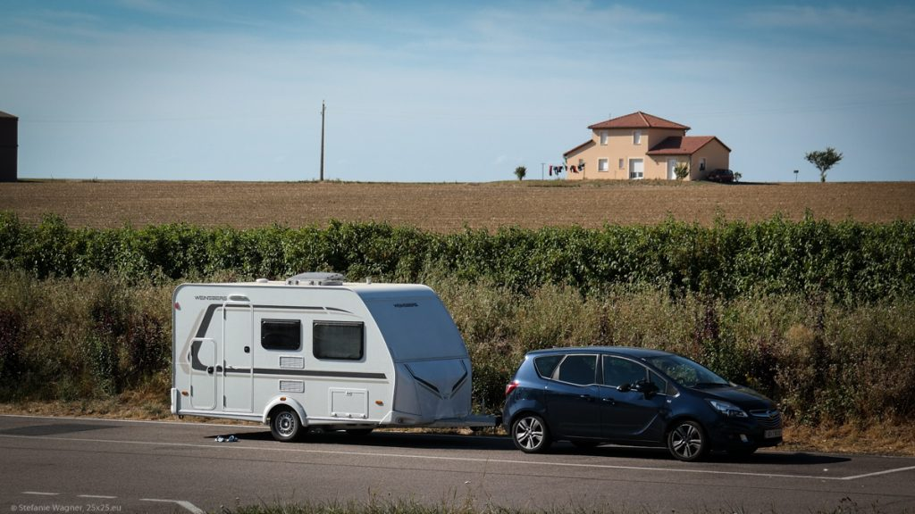 View across a parking area with only the car and the caravan